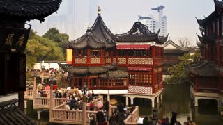 High angle shot of people on the nine-turn zig-zag bridge at Yuyuan Bazaar, Huxingting Teahouse (Mid-Lake Pavilion Teahouse), Shanghai, China, T/Lapse