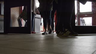 High School Hallway - close up of feet as students enter