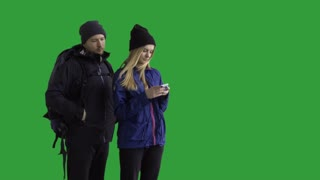 Hikers couple taking a selfie - green screen. Prores 422HQ 4K UHD 60FPS slow motion shot. Shot with Blackmagic URSA Mini