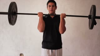 Hispanic bodybuilder training with weights