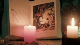 History of Christmas Children's Bible by candles