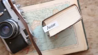Holiday idea. Photo camera, and travel map.