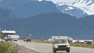 Homer Spit Road Traffic with Mountains in the Background