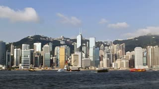 Hong Kong's Victoria Harbour with the skyscrapers of the financial and business district of Central on Hong Kong Island, China, Asia