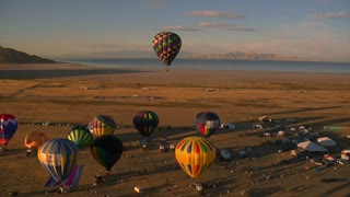 Hot Air Balloon Festival Shot From The Air With Lake In Distance