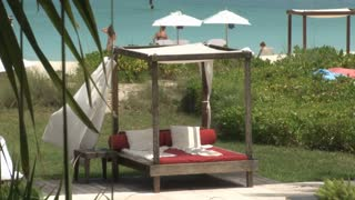 Hotel Resort Cabanas and Chairs at Oceanfront Beach 4