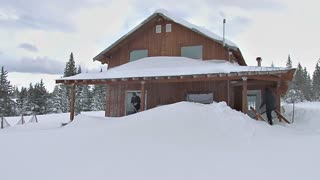 House Covered in Snow After Blizzard