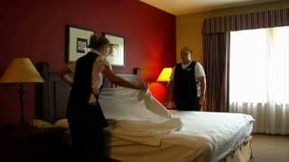 Housekeepers In The Hotel Room Change Bedding
