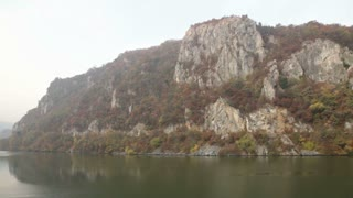 Huge Cliffs Along Waterway in Romania