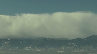 Huge White Clouds Rolling On Mountain Top