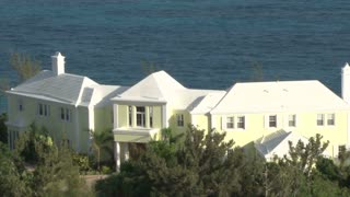 Huge Yellow Mansion Along Water in Bermuda