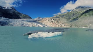 ice floe swimming in glacier lake. melting glaciers ice. aerial view landscape