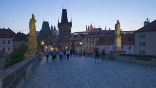 Illuminated Charles Bridge (Karluv Most) Prague, Czech Republic, with Hradcany Castle in the  background, T/Lapse