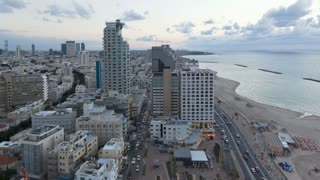 Illuminated elevated day to night view of beachfront hotels, Tel Aviv, Israel, Middle East, Time lapse