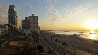 Illuminated elevated sunset and night view of beachfront hotels, Tel Aviv, Israel, Middle East, Time lapse