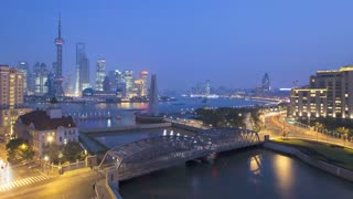 Illuminated New Pudong skyline, Waibaidu (Garden) Bridge, looking across the Huangpu River from the Bund, Shanghai, China, T/Lapse