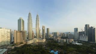 Illuminated night to day view over Kuala Lumpur City Centre (KLCC) & Petronas Towers, Kuala Lumpur, Malaysia, Time lapse