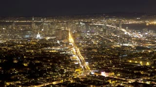 Illuminated view of the city skyline, viewed from Twin Peaks, San Francisco, California, United States of America T/lapse