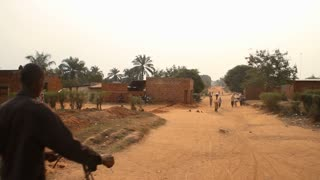 In Rural African Village Road With Bicyclists And Pedestrians