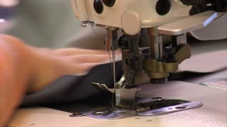 Industrial Sewing Machine In Operation