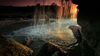 Inside Shot of a Waterfall at Sunset