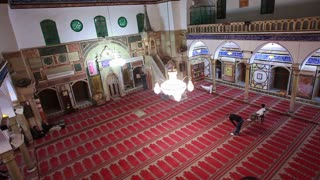 Interior Shot of Man in Prayer at Mosque