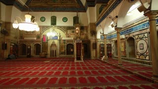 Interior Shot of Mosque with people Engaged in Prayer 2