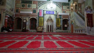Interior Shot of Mosque with people Engaged in Prayer 3