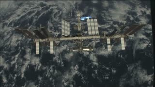 ISS Orbitting Earth Seas and Clouds