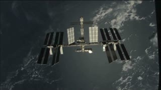 ISS Passing Over Earth Upper Atmosphere