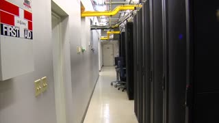 It Technician Walks In Computer Server Room