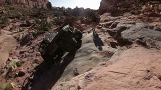 Jeep Bouncing Up Rock Ledge 2