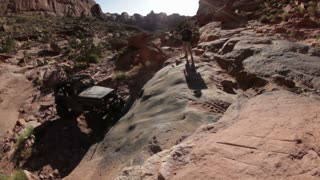 Jeep Bouncing Up Rock Ledge 3