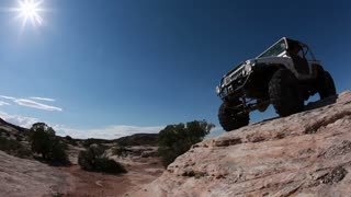Jeep Carefully Rolls Down Steep Ledge