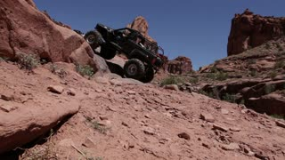 Jeep Climbing Up Steep Rock Ledges