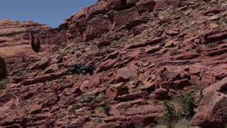 Jeep Driving Path Through Redrock Formation
