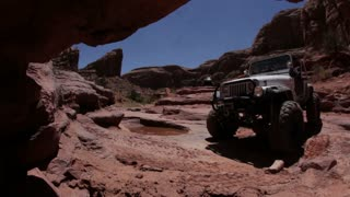 Jeep Off Roading Filmed From Under Rock Ledge