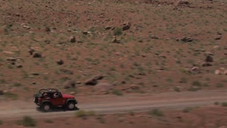 Jeep Wrangler Driving on Rough Terrain