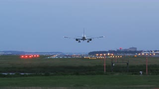 Jet Liner Landing On Distant Runway