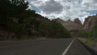 Jib Shot Of Three Motorcycles Passing Camera In Capitol Reef National Park