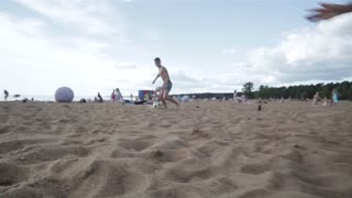 Kids Enjoy Sport On Sand