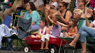 Kids In Red Wagon Watch Parade