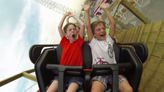 Kids Riding Front of Rollercoaster