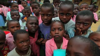 Kids Swarm Around the Camera in Africa