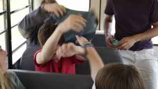 Kids Take Students Backpack on Bus