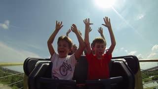 Kids Waving Arms in the Front Seat of Roller Coaster