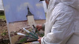 KIRILLOV, RUSSIA - May 11: Artist paints a picture of Kirillo-Belozersky Monastery. It's used to be the largest monastery of Northern Russia. Shot on May 11, 2013 in Kirillov, Russia.