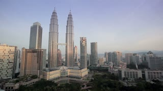 Kuala Lumpur City Centre urban development which includes the KLCC park convention and shopping centre and the iconic 88 storey steel clad Petronas Towers, illuminated at dusk, Kuala Lumpur, KLCC, Selangor State, Malaysia, Asia