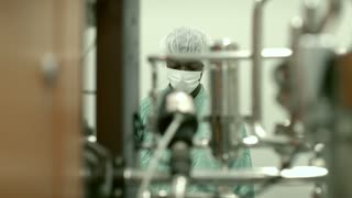 Lab technician working as researcher in biotechnology plant with equipment, machinery