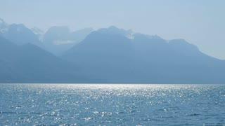 lake mountain panorama view. sunshine magic hour. water surface